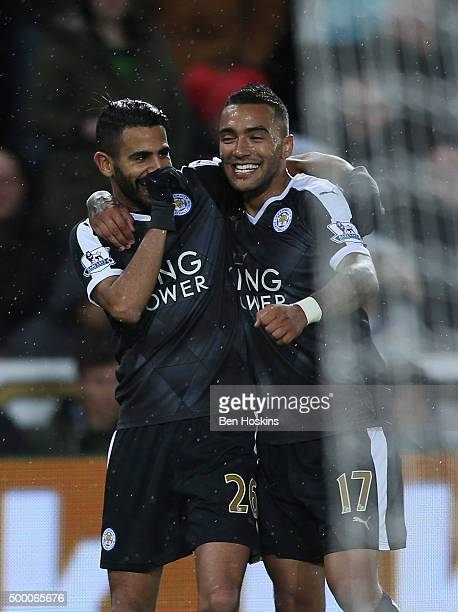 Riyad Mahrez of Leicester City celebrates scoring his team's third and hat trick goal with his team mate Danny Simpson during the Barclays Premier...