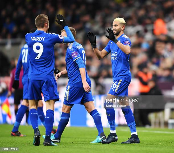 Riyad Mahrez of Leicester City celebrates scoring the first Leicester goal with Jamie Vardy of Leicester City during the Premier League match between...