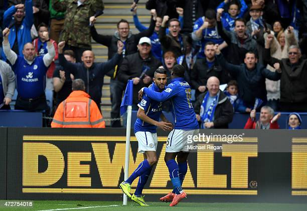 Riyad Mahrez of Leicester City celebrates scoring the opening goal with Jeffrey Schlupp during the Barclays Premier League match between Leicester...