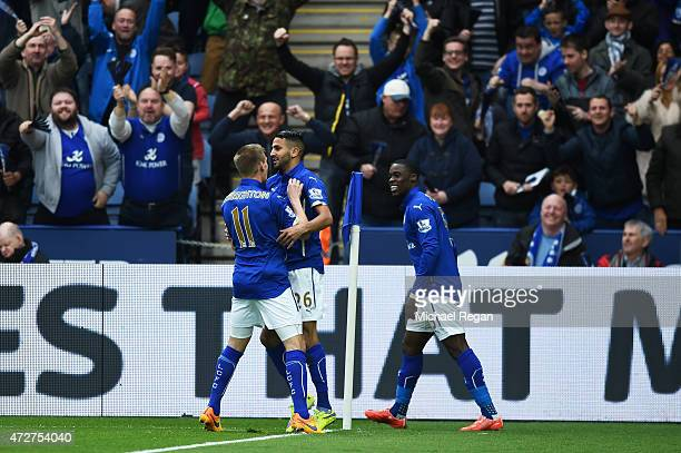 Riyad Mahrez of Leicester City celebrates scoring the opening goal with team mate Marc Albrighton during the Barclays Premier League match between...
