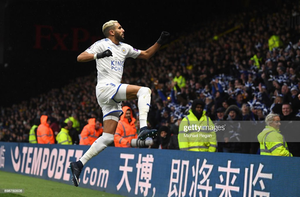 Riyad Mahrez of Leicester City celebrates scoring the opening goal during the Premier League match between Watford and Leicester City at Vicarage Road on December 26, 2017 in Watford, England.