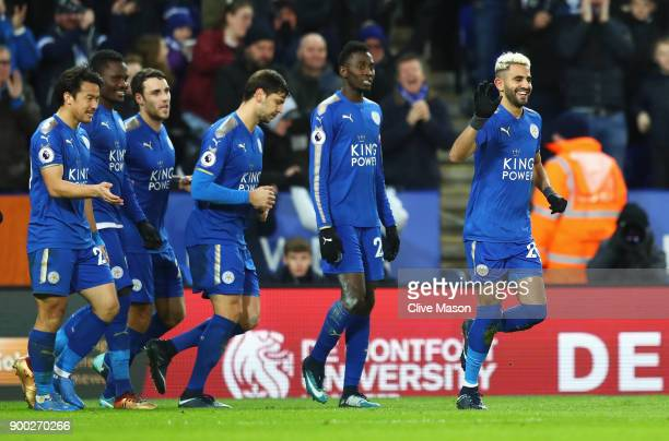 Riyad Mahrez of Leicester City celebrates scoring the opening goal during the Premier League match between Leicester City and Huddersfield Town at...