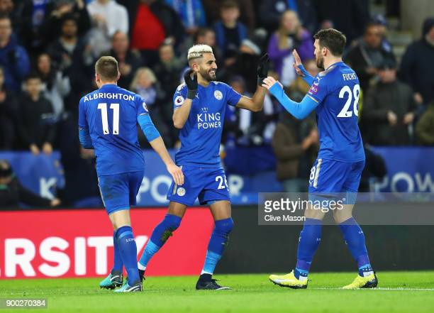 Riyad Mahrez of Leicester City celebrates scoring the opening goal with Christian Fuchs during the Premier League match between Leicester City and...