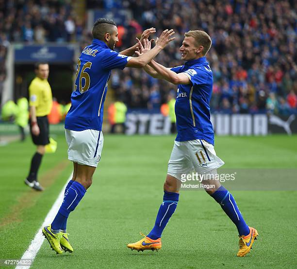 Riyad Mahrez of Leicester City celebrates scoring the second goal with Marc Albrighton during the Barclays Premier League match between Leicester...