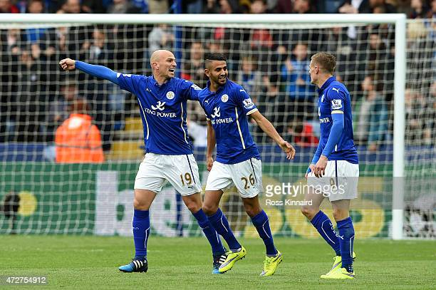Riyad Mahrez of Leicester City celebrates scoring the second goal with Esteban Cambiasso during the Barclays Premier League match between Leicester...