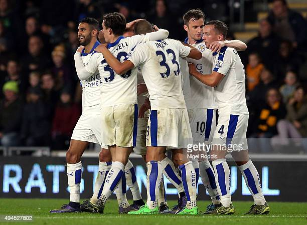 Riyad Mahrez of Leicester City celebrates scoring with teamates during the Capital One Cup Fourth Round match between Hull City and Leicester City at...
