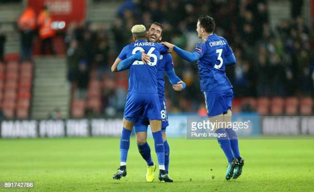 Riyad Mahrez of Leicester City celebrates with Christian Fuchs and Ben Chilwell of Leicester City after scoring to make it 01 during the Premier...