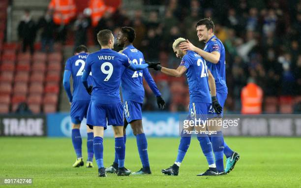Riyad Mahrez of Leicester City celebrates with Harry Maguire and Jamie Vardy of Leicester City after scoring to make it 01 during the Premier League...