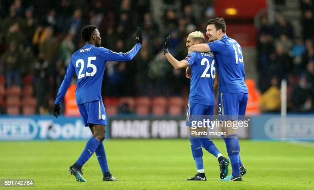 Riyad Mahrez of Leicester City celebrates with Harry Maguire and Wilfred Ndidi of Leicester City after scoring to make it 01 during the Premier...
