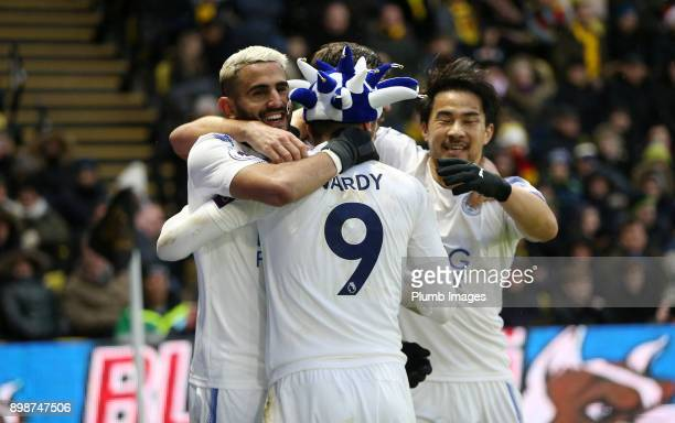 Riyad Mahrez of Leicester City celebrates with Jamie Vardy Shinji Okazaki and Aleksandar Dragovic of Leicester City after scoring to make it 01...