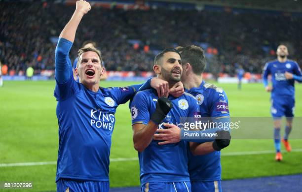 Riyad Mahrez of Leicester City celebrates with Marc Albrighton of Leicester City after scoring to make it 20 during the Premier League match between...