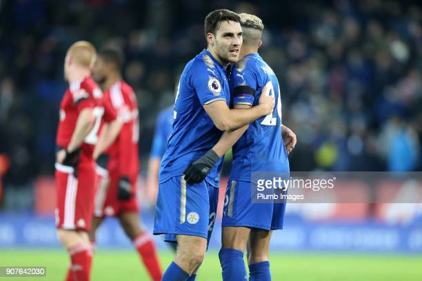 Riyad Mahrez of Leicester City celebrates with Matty James of Leicester City after scoring to make it 20 during the Premier League match between...