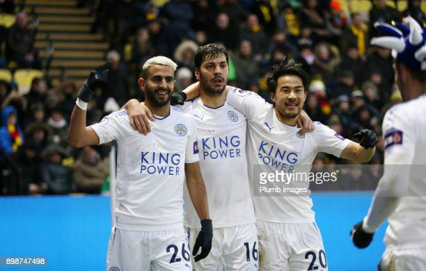 Riyad Mahrez of Leicester City celebrates with Shinji Okazaki and Aleksandar Dragovic of Leicester City after scoring to make it 01 during the...