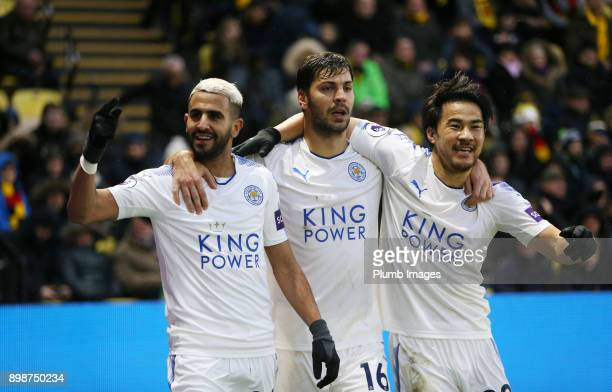 Riyad Mahrez of Leicester City celebrates with Shinji Okazaki and Aleksandar Dragovic of Leicester City after scoring to make it 01 during the...