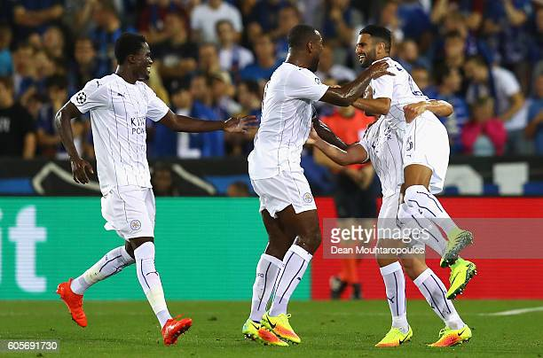 Riyad Mahrez of Leicester City celebrates with team mates as he scores from a free kick for their second goal during the UEFA Champions League match...