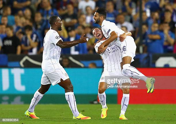 Riyad Mahrez of Leicester City celebrates with team mates Wes Morgan and Daniel Drinkwater during the UEFA Champions League match between Club Brugge...