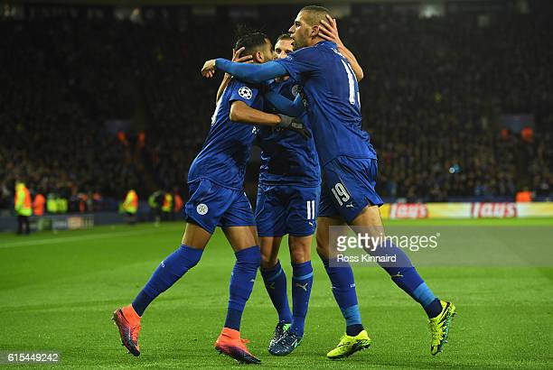 Riyad Mahrez of Leicester City cleebrates scoring his team's first goal with his team mates Marc Albrighton and Islam Slimani during the UEFA...