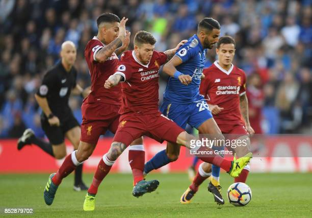 Riyad Mahrez of Leicester City comes under pressure from Alberto Moreno Roberto Fimino and Philippe Coutinho of Liverpool during the Premier League...
