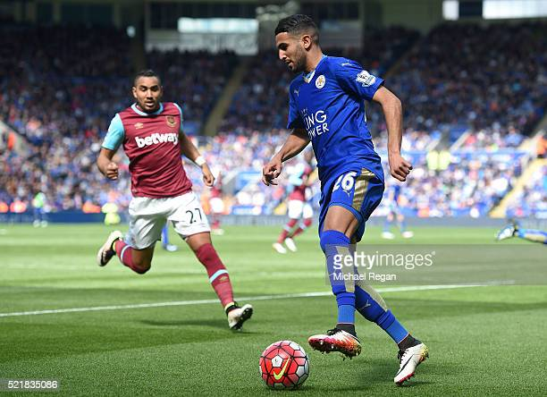 Riyad Mahrez of Leicester City controls the ball ahead of Dimitri Payet of West Ham United during the Barclays Premier League match between Leicester...