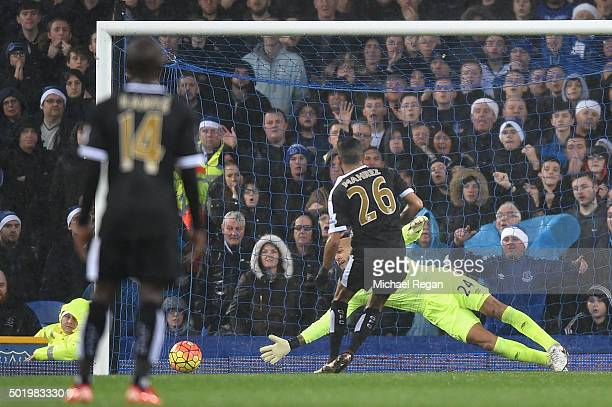Riyad Mahrez of Leicester City converts the penalty to score his team's first goal during the Barclays Premier League match between Everton and...