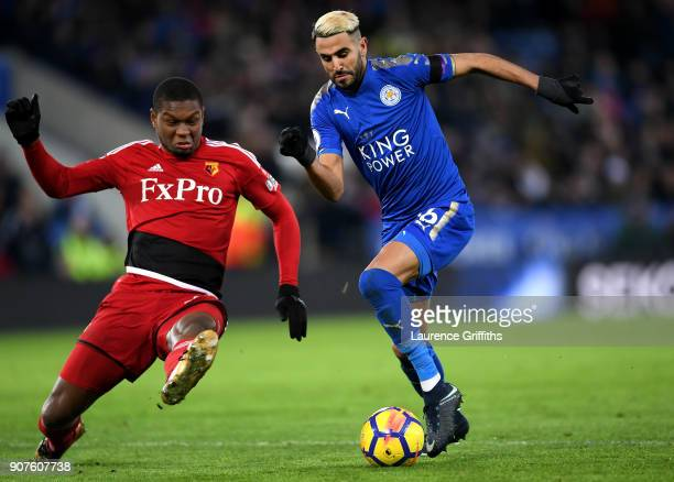 Riyad Mahrez of Leicester City escapes a challenge from Marvin Zeegelaar of Watford on the way to the scoring his siddes first goal during the...