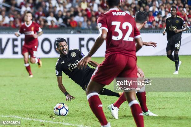 Riyad Mahrez of Leicester City falls during a game against Liverpool FC at the final of the 2017 Premier League Asia Trophy football tournament at...