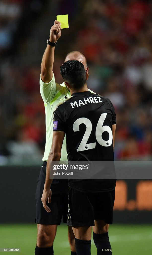 Riyad Mahrez of Leicester City gets a yellow card during the Premier League Asia Trophy match between Liverpool FC and Leicester City FC at the Hong Kong Stadium on July 22, 2017 in Hong Kong, Hong Kong.