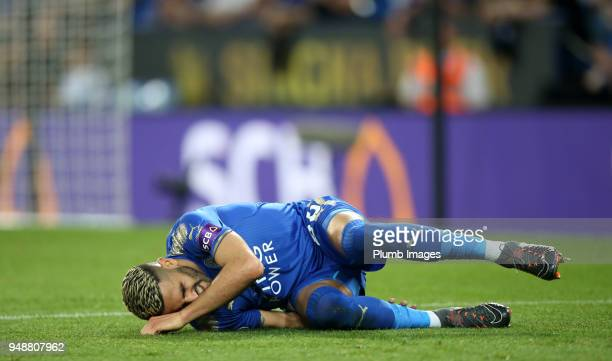 Riyad Mahrez of Leicester City goes down in pain during the Premier League match between Leicester City and Southampton at King Power Stadium on...