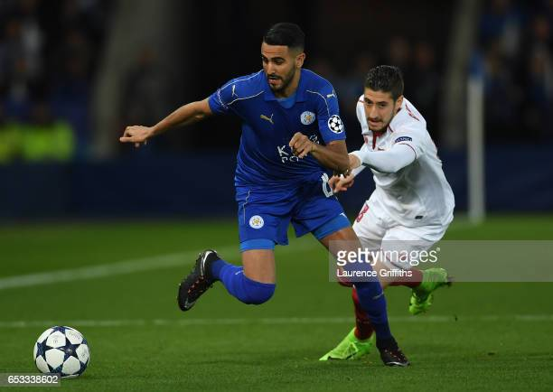 Riyad Mahrez of Leicester City goes past Sergio Escudero of Sevilla during the UEFA Champions League Round of 16 second leg match between Leicester...