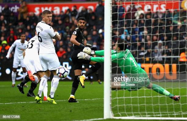 Riyad Mahrez of Leicester City heads wide past Lukasz Fabianski of Swansea City during the Premier League match between Swansea City and Leicester...