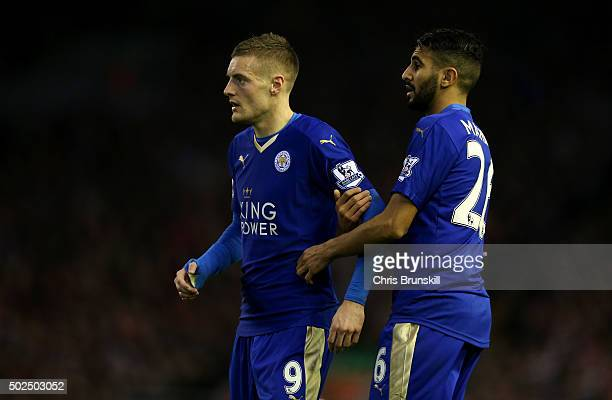Riyad Mahrez of Leicester City holds back Jamie Vardy of Leicester City during the Barclays Premier League match between Liverpool and Leicester City...