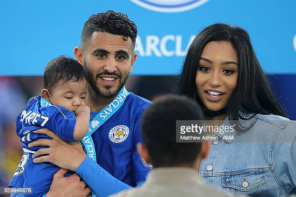 Riyad Mahrez of Leicester City holds daughter Inaya as wife Rita looks on as Leicester City celebrate becoming Premier League Champions for the...