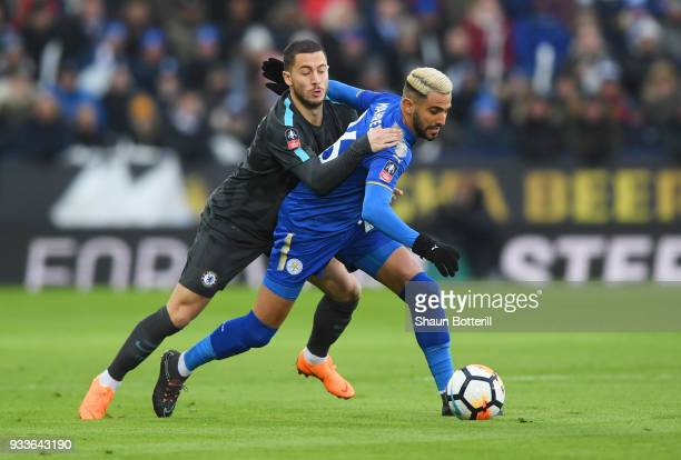 Riyad Mahrez of Leicester City holds off Eden Hazard of Chelsea during The Emirates FA Cup Quarter Final match between Leicester City and Chelsea at...