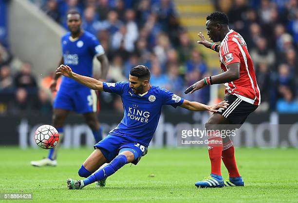 Riyad Mahrez of Leicester City holds off Victor Wanyama of Southampton during the Barclays Premier League match between Leicester City and...