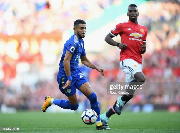 Riyad Mahrez of Leicester City in action during the Premier League match between Manchester United and Leicester City at Old Trafford on August 26...