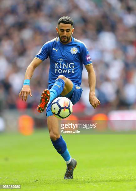 Riyad Mahrez of Leicester City in action during the Premier League match between Tottenham Hotspur and Leicester City at Wembley Stadium on May 13...