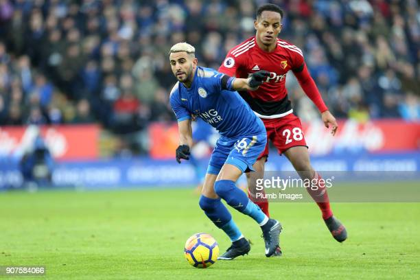 Riyad Mahrez of Leicester City in action with Andre Carrillo of Watford during the Premier League match between Leicester City and Watford at King...