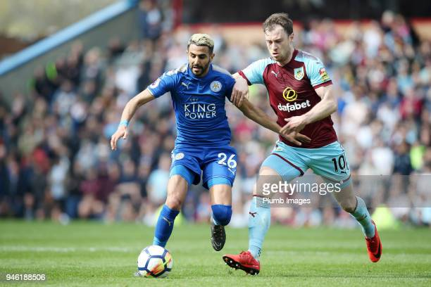 Riyad Mahrez of Leicester City in action with Ashely Barnes of Burnley during the Premier League match between Burnley and Leicester City at Turf...