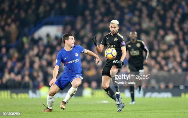 Riyad Mahrez of Leicester City in action with Cesar Azpilicueta of Chelsea during the Premier League match between Chelsea and Leicester City at...