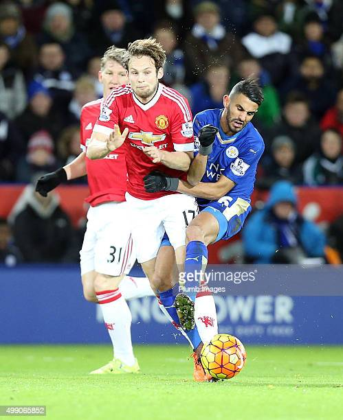 Riyad Mahrez of Leicester City in action with Daley Blind of Manchester United during the Barclays Premier League match between Leicester City and...