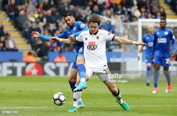 Riyad Mahrez of Leicester City in action with Daryl Janmaat of Watford during of the Premier League match between Leicester City and Watford at King...
