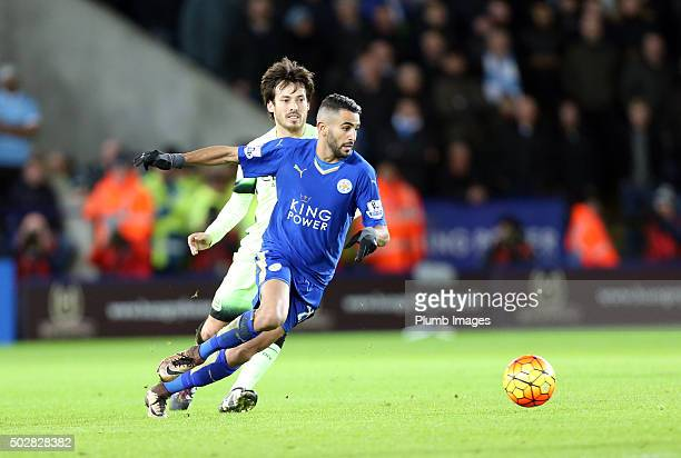 Riyad Mahrez of Leicester City in action with David Silva of Manchester City during the Barclays Premier League match between Leicester City and...