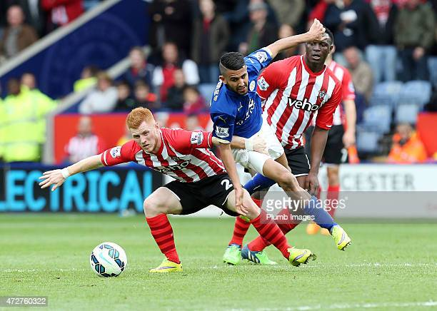 Riyad Mahrez of Leicester City in action with Harrison Reed of Southampton during the Premier league match between Leicester City and Southampton at...