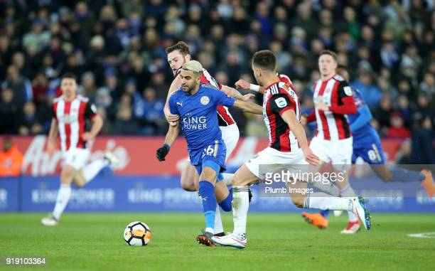 Riyad Mahrez of Leicester City in action with Jack O'Connell and George Baldock of Sheffield United during the FA Cup fifth round match between...