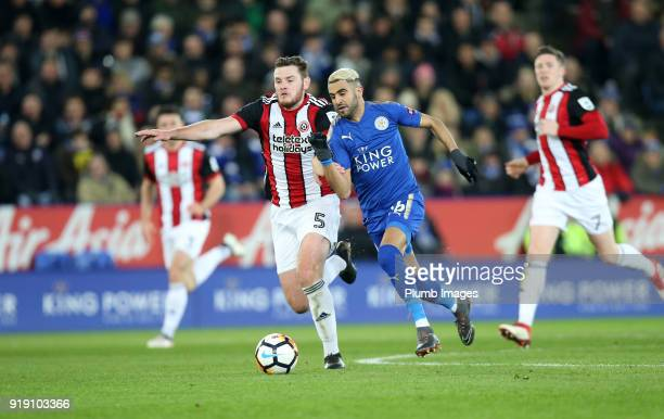 Riyad Mahrez of Leicester City in action with Jack O'Connell of Sheffield United during the FA Cup fifth round match between Leicester City and...