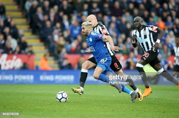 Riyad Mahrez of Leicester City in action with Jonjo Shelvey of Newcastle United during the Premier League match between Leicester City and Newcastle...