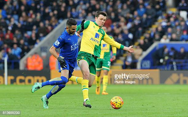 Riyad Mahrez of Leicester City in action with Jonny Howson of Norwich City during the Barclays Premier League match between Leicester City and...