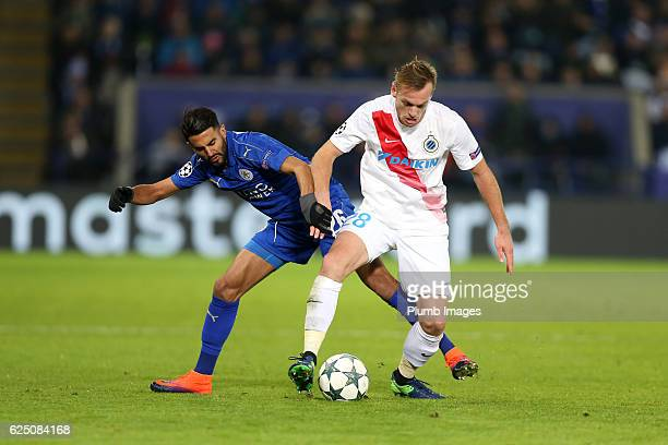 Riyad Mahrez of Leicester City in action with Laurens De Bock of Club Brugge during the UEFA Champions League match between Leicester City and Club...
