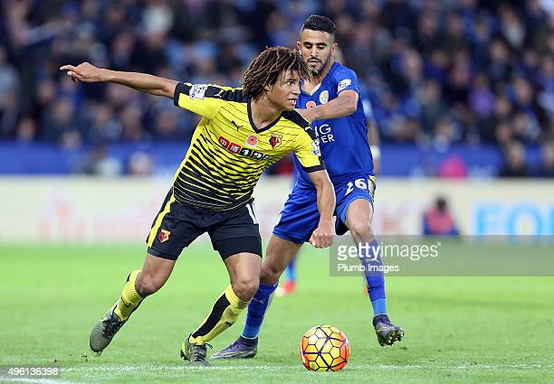 Riyad Mahrez of Leicester City in action with Nathan Ake of Watford during the Barclays Premier League match between Leicester City and Watford at...