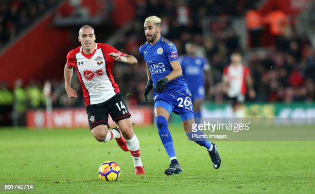 Riyad Mahrez of Leicester City in action with Oriol Romeu of Southampton during the Premier League match between Southampton and Leicester City at St...